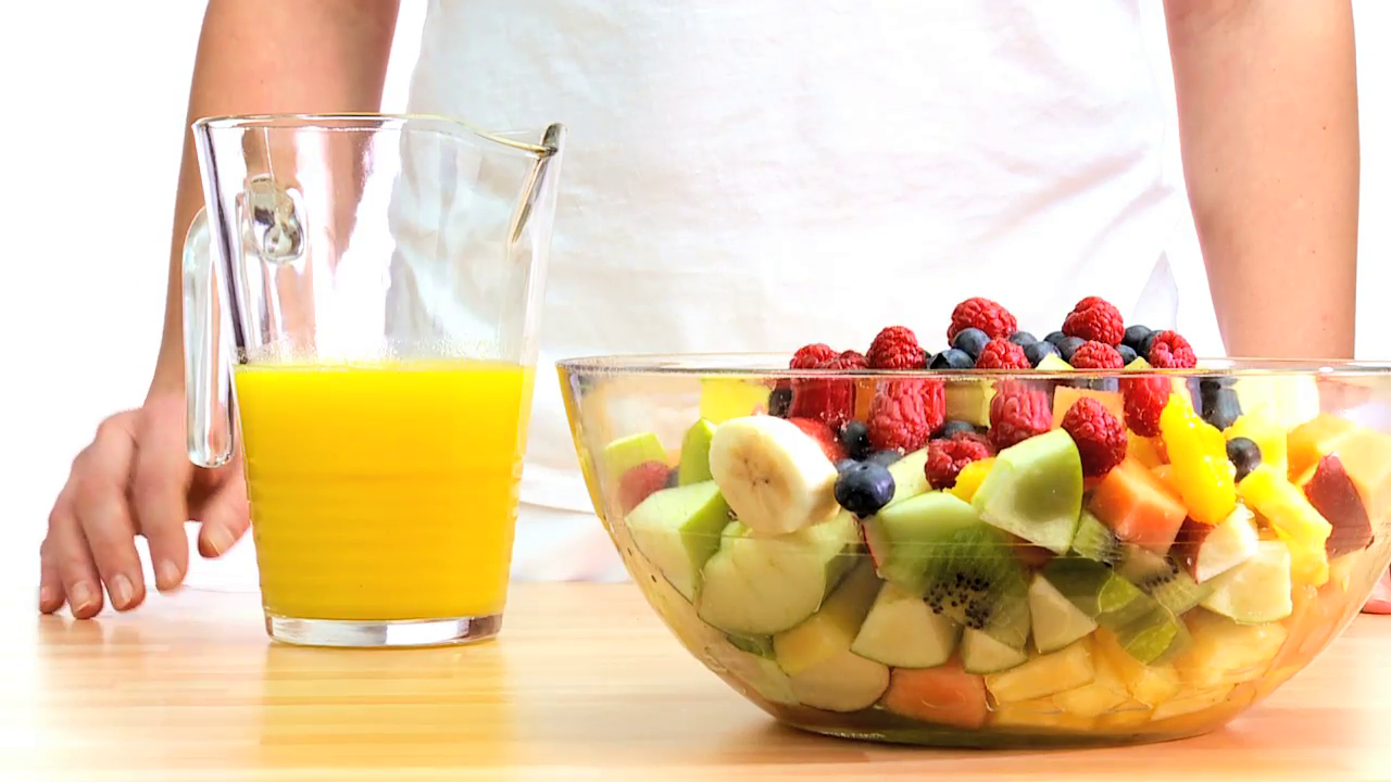 fresh-orange-juice-being-poured-over-a-bowl-of-healthy-mixed-fruit-salad_v1no0ihyg__F0000 (2)